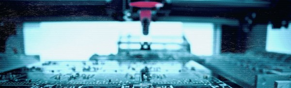 a red needle over a computer chip