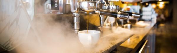 barista machine pouring espresso into cup