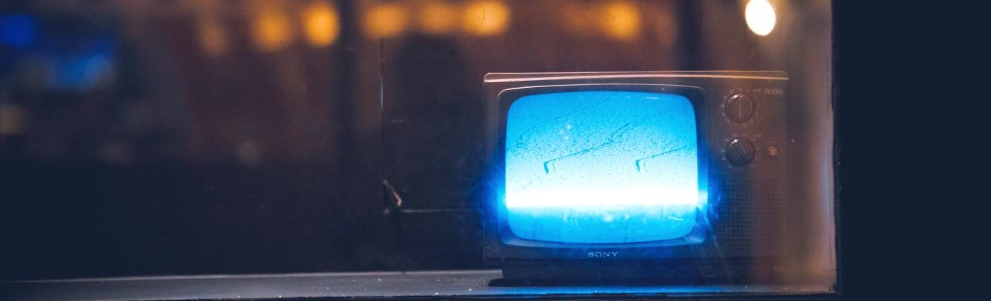 small TV set on windowsill