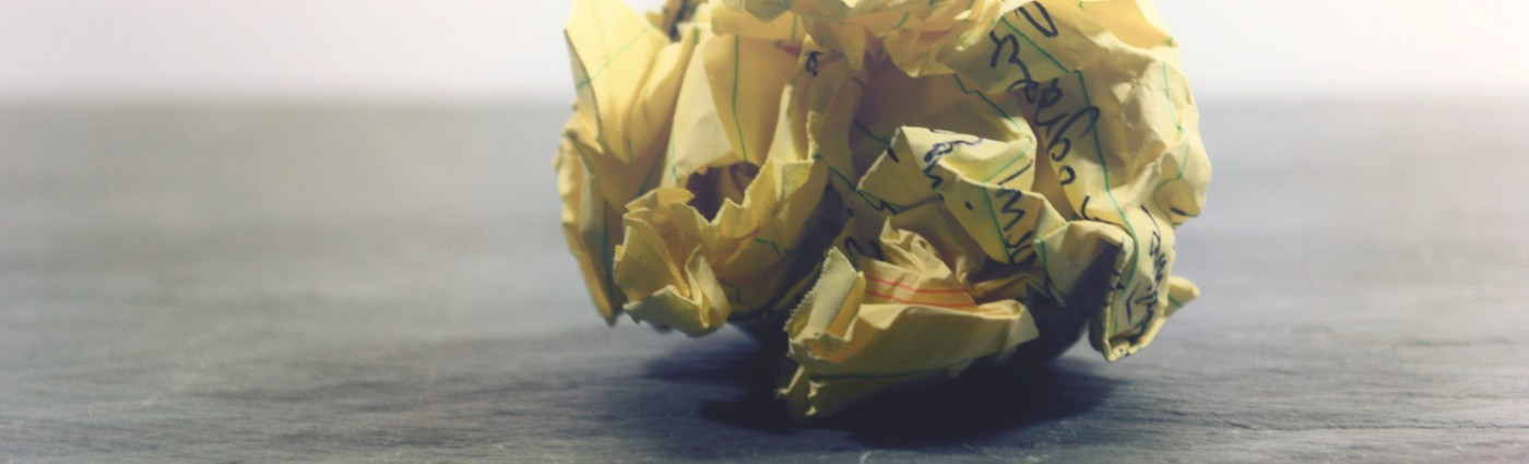 crumpled ball of yellow paper