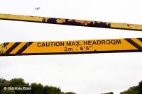 "metal beam reading 'Caution max headroom 2m 6'6""'"
