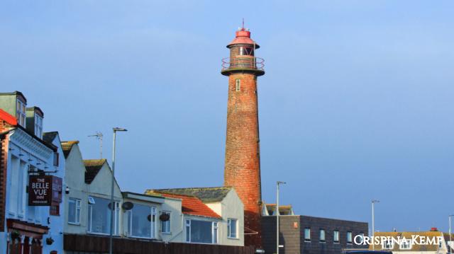 brick lighthouse above a street